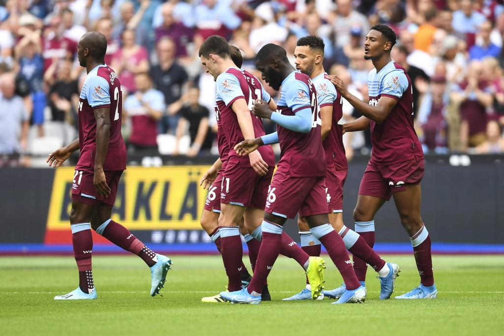 West Ham players celebrate after Sebastien Haller scored during the English Premier League soccer match between West Ham United and Norwich at London