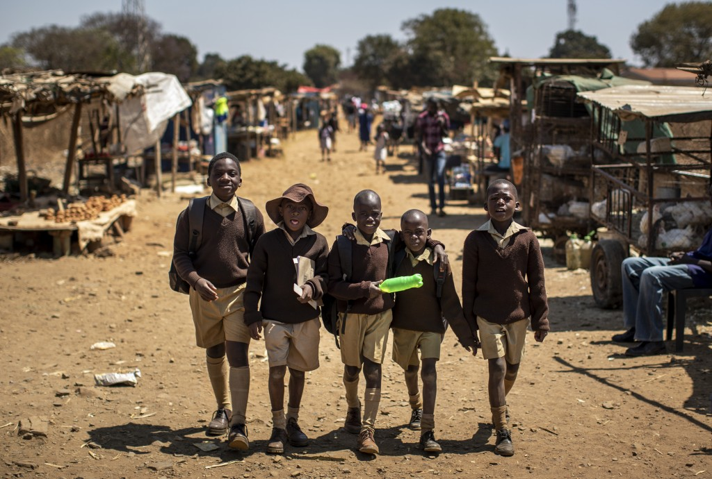 Schoolboys walk back home on the first day of the school term, in Kuwadzana, on the outskirts of the capital Harare, in Zimbabwe, Sept. 10, 2019. Zimb...