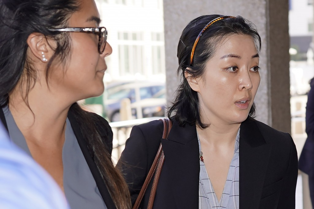 Tiffany Li, right, arrives at the courthouse Thursday, Sept. 12, 2019, in Redwood City, Calif. The trial of Li, a Chinese real estate scion who posted