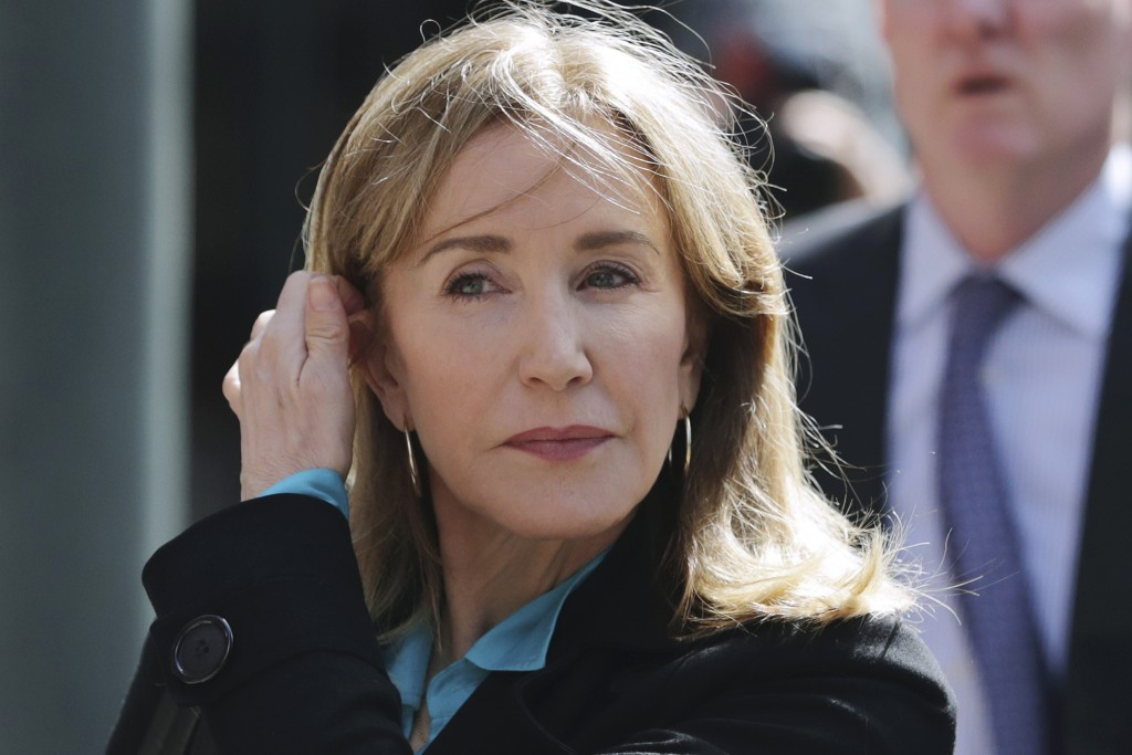 FILE - In this April 3, 2019 file photo, actress Felicity Huffman arrives at federal court in Boston to face charges in a nationwide college admission