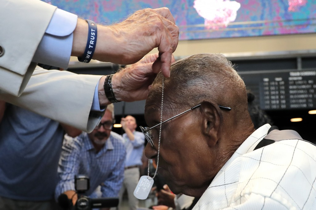 World War II veteran Lawrence Brooks receives a dog tag honoring whims the oldest living World War II veteran as he celebrates his 110th birthday at t...