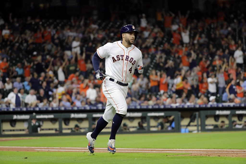 Houston Astros' George Springer (4) runs the bases after hitting a home run against the Oakland Athletics during the first inning of a baseball game T...
