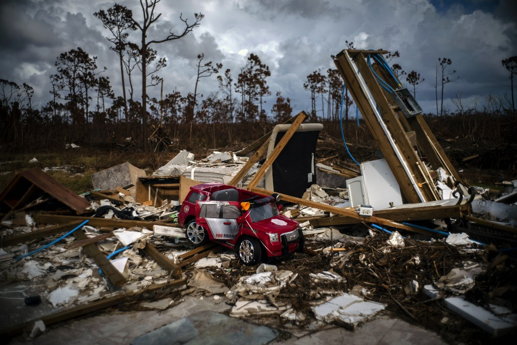 A toy fire engine sits in the rubble of a house destroyed by Hurricane Dorian in Gold Rock Creek, Grand Bahama, Bahamas, Thursday Sept. 12, 2019. Near...