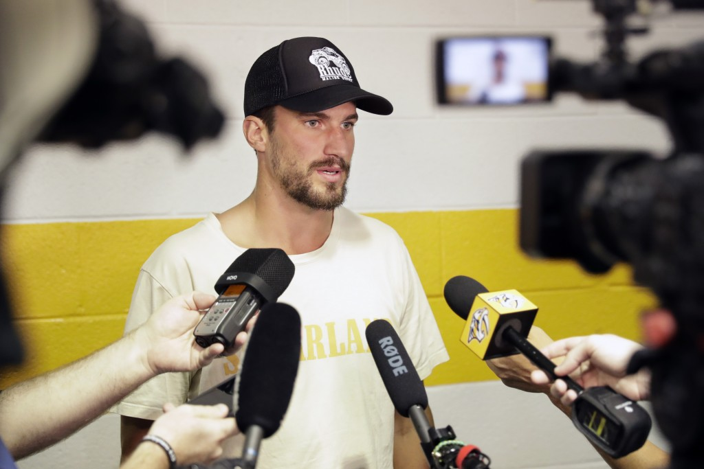 Nashville Predators defenseman Roman Josi, of Switzerland, answers questions as players report to NHL hockey training camp Thursday, Sept. 12, 2019, i