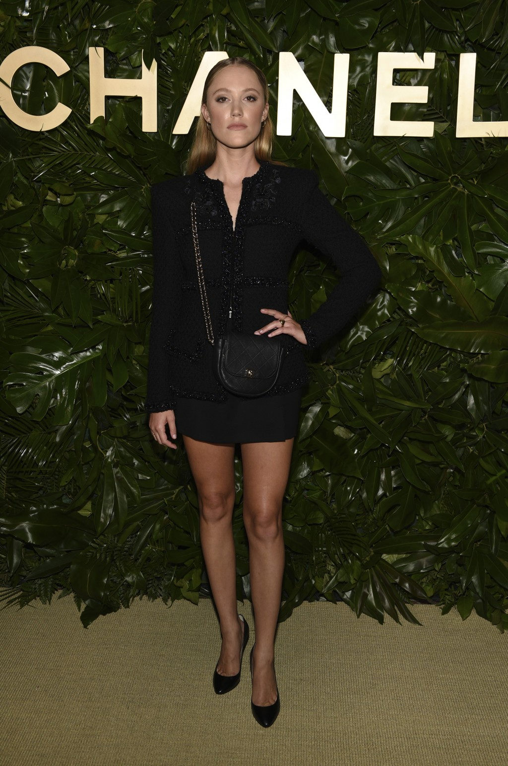 Actress Maika Monroe poses at the launch of the Gabrielle Chanel Essence fragrance at the Chateau Marmont, Thursday, Sept. 12, 2019, in Los Angeles. (