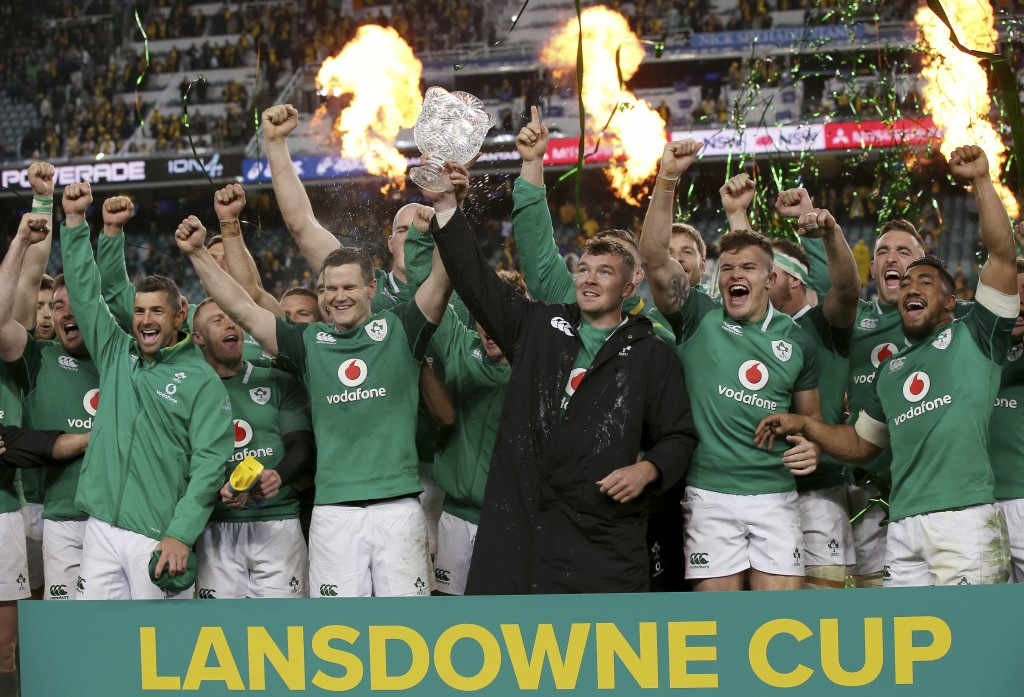 FILE - In this Saturday, June 23, 2018 file photo, Ireland's Peter O'Mahony, center, holds up the Lansdowne Cup as he celebrates with teammates follow...
