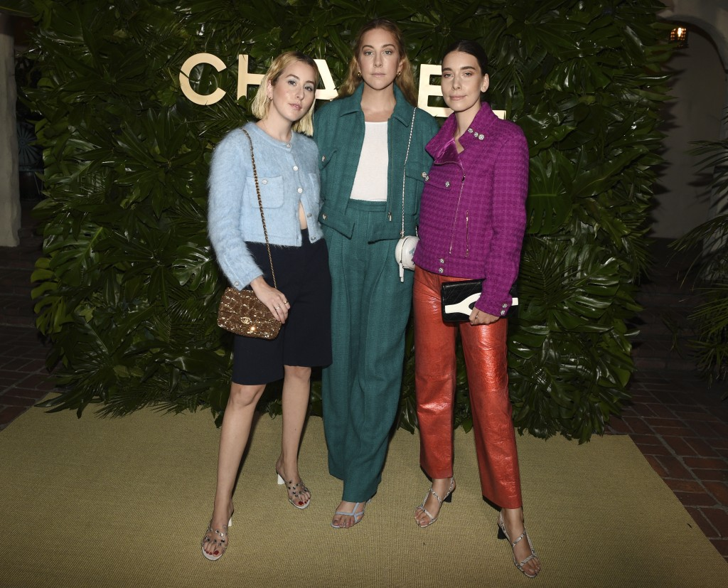 Sisters Alana, left, Este, center, and Danielle Haim of the band HAIM pose together at the launch of the Gabrielle Chanel Essence fragrance at the Cha...