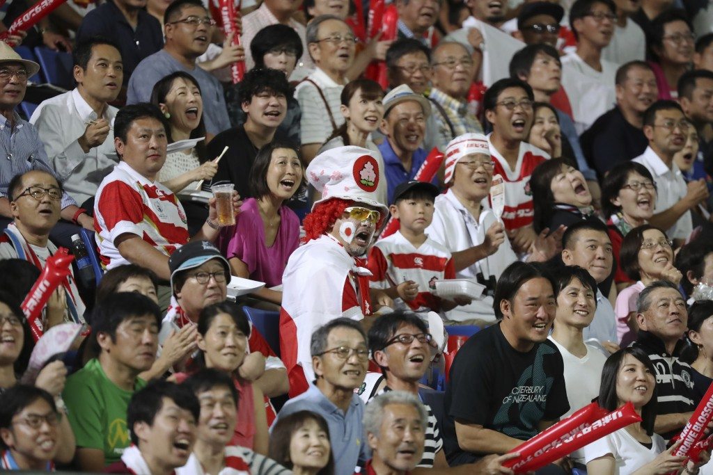 Fans react during a rugby match between Japan and South Africa at Kumagaya Rugby Stadium Friday, Sept. 6, 2019, in Saitama, Japan. (AP Photo/Eugene Ho...