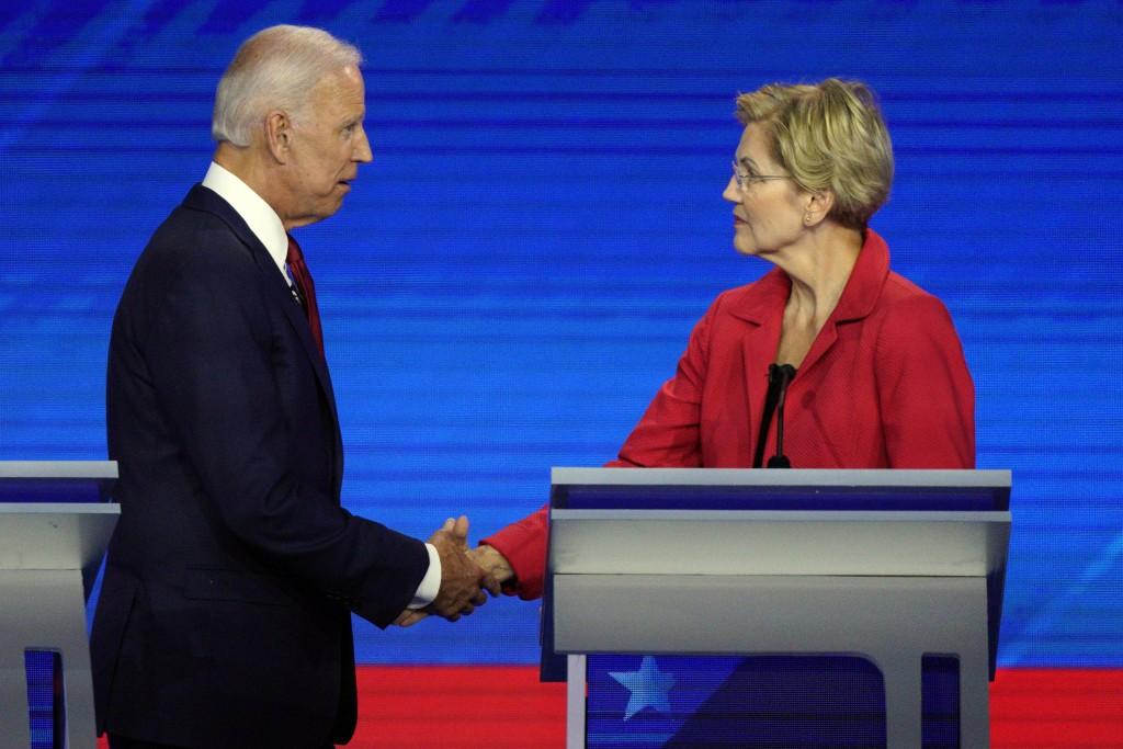 Democratic presidential candidates former Vice President Joe Biden, left, and Sen. Elizabeth Warren, D-Mass., shake hands Thursday, Sept. 12, 2019, af...