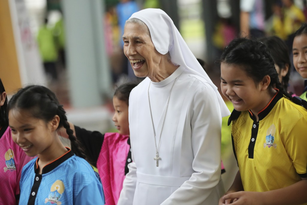 In this Aug. 27, 2019, photo, ST. Mary's School Vice Principal Sister Ana Rosa Sivori, center,  talks to students during a lunch break at the girls' s