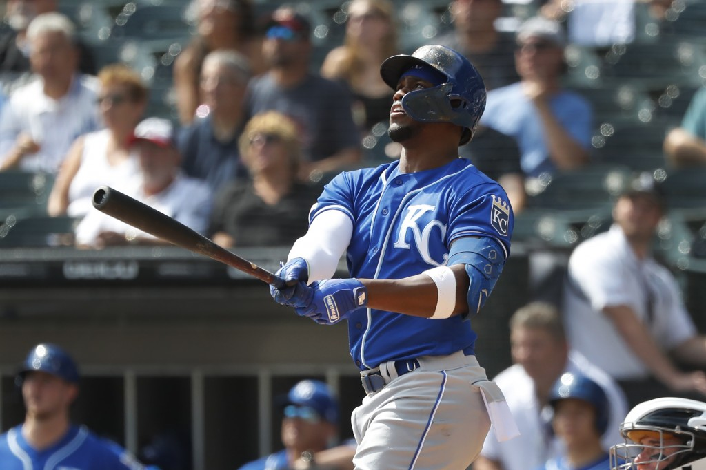 Kansas City Royals' Jorge Soler watches his home run off Chicago White Sox starting pitcher Lucas Giolito during the first inning of a baseball game T...