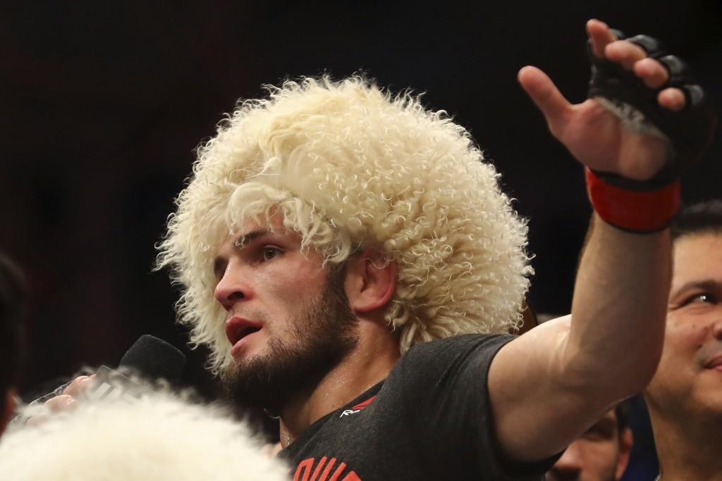 Russian UFC fighter Khabib Nurmagomedov, speaks after wining against UFC fighter Dustin Poirier, of Lafayette, La., during Lightweight title mixed mar...
