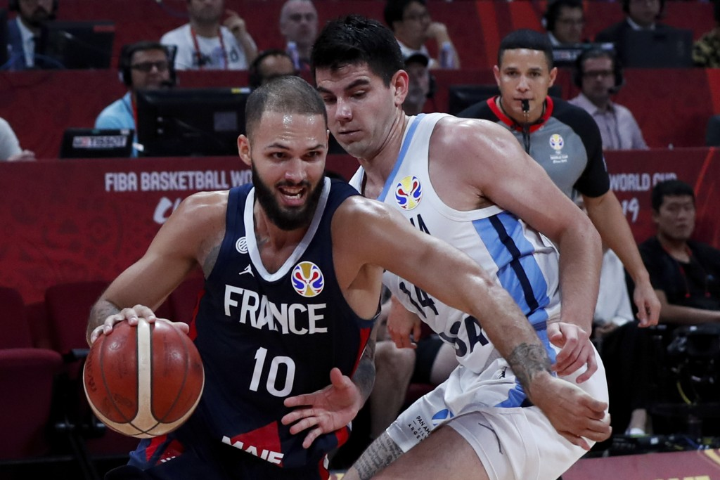 Evan Fournier of France tries to get past Gabriel Deck of Argentina during their semifinals match for the FIBA Basketball World Cup at the Cadillac Ar...