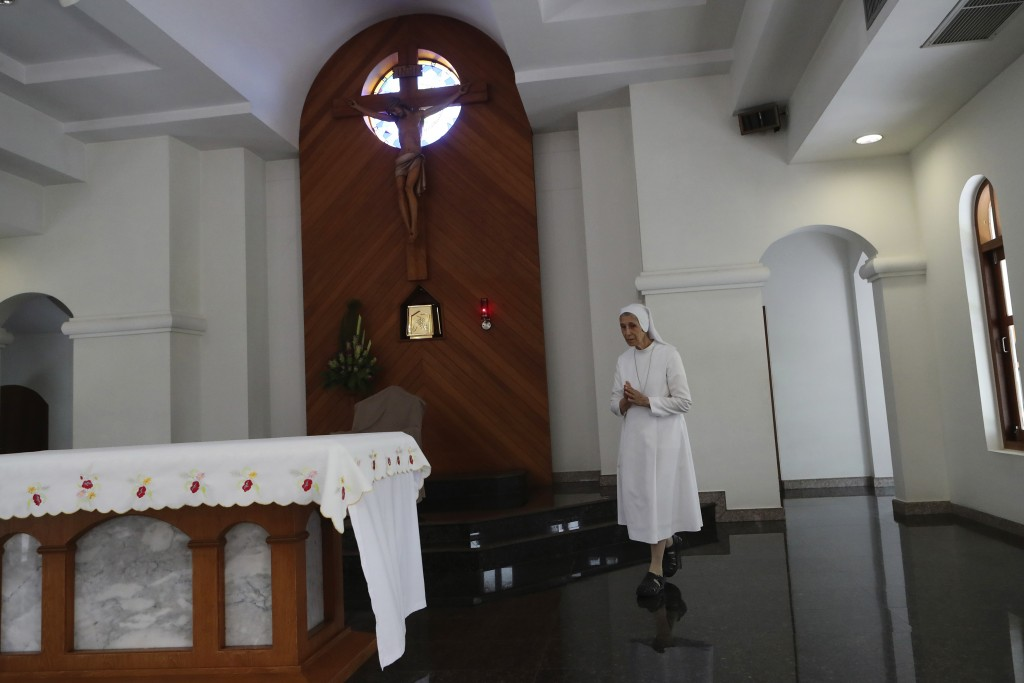 In this Aug. 27, 2019, photo, ST. Mary's School Vice Principal Sister Ana Rosa Sivori prays inside a church at the girls' school in Udon Thani, about