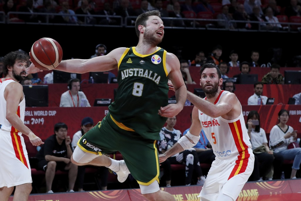 Matthew Dellavedova of Australia tries to pass the ball over Rudy Fernandez of Spain during their semifinals match for the FIBA Basketball World Cup a...