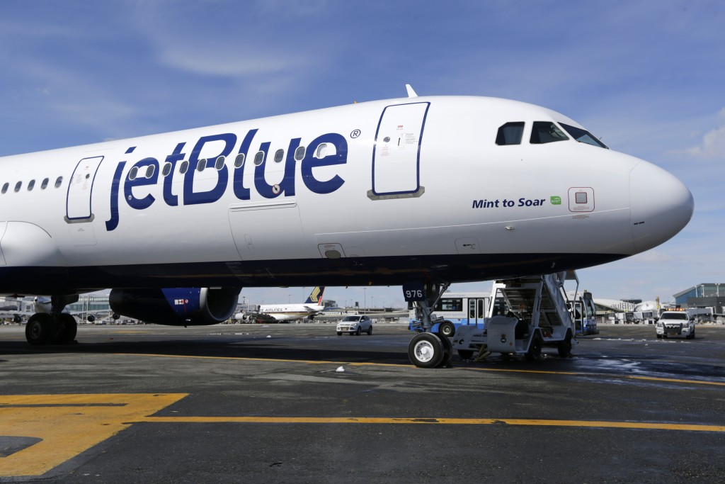 FILE- In this March 16, 2017, file photo, a Jet Blue airplane at John F. Kennedy International Airport in New York. A new report says U.S. airlines ar
