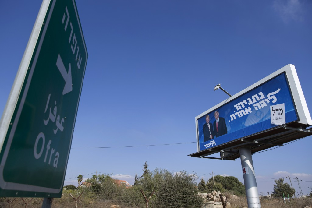 In this Wednesday, Sept. 11, 2019 photo, an election campaign billboard for the Likud party shows Israeli Prime Minister Benjamin Netanyahu and U.S. P...