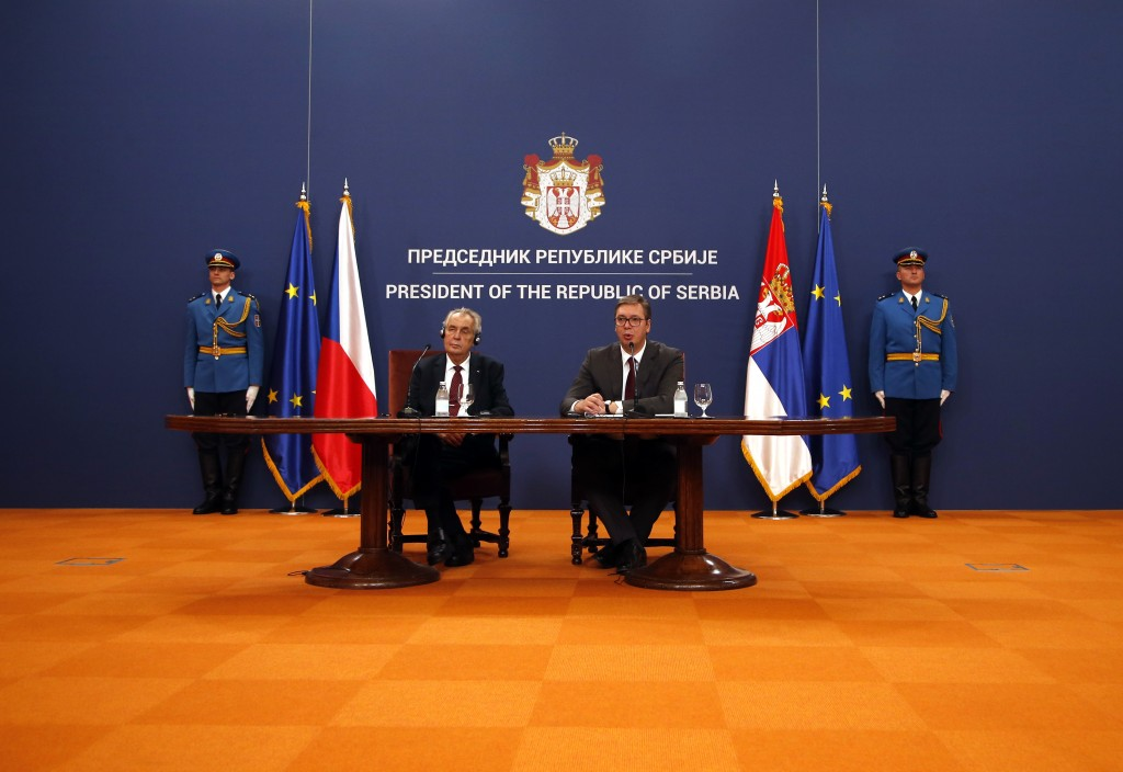 Czech Republic's President Milos Zeman, front left, listens his Serbian counterpart Aleksandar Vucic during a press conference after a meeting at the