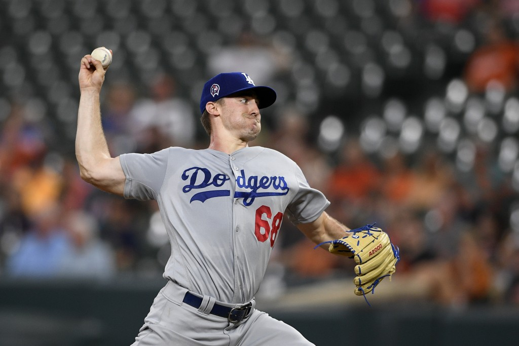 Los Angeles Dodgers starting pitcher Ross Stripling throws during the first inning of the team's baseball game against the Baltimore Orioles, Wednesda...