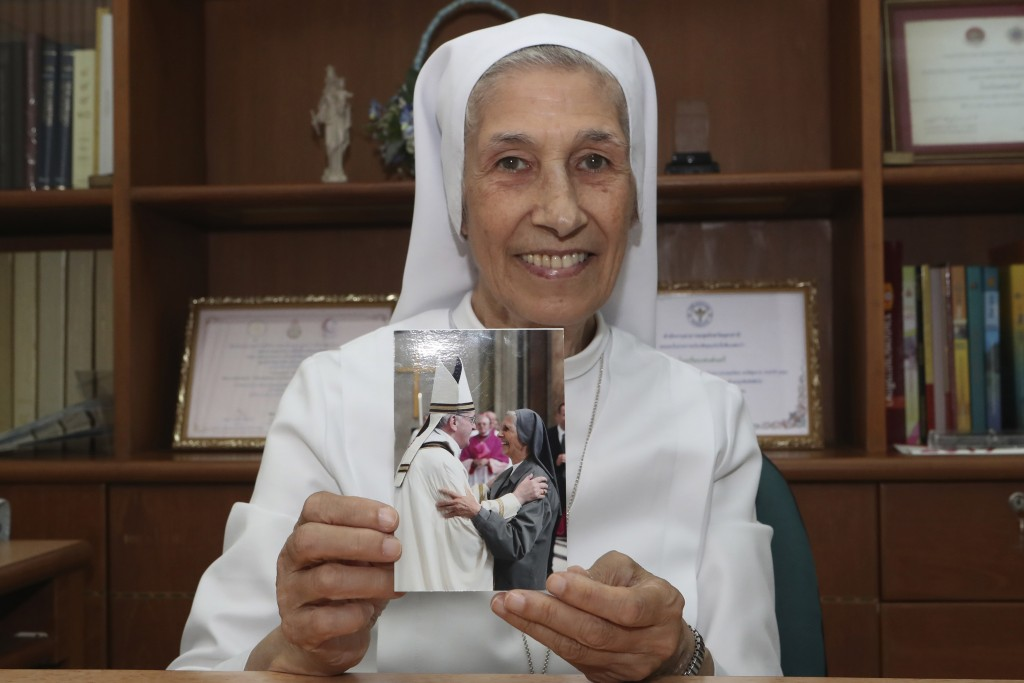 In this Aug. 27, 2019, photo, ST. Mary's School Vice Principal Sister Ana Rosa Sivori shows a picture taken with Pope Francis, at the girls' school in