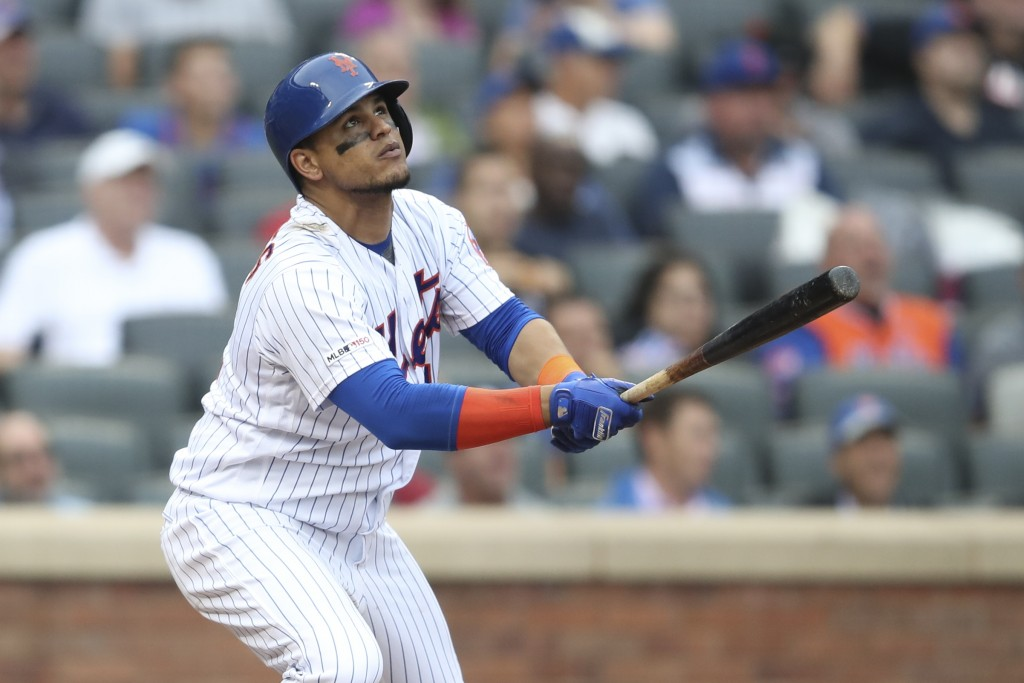 New York Mets' Juan Lagares watches the ball after hitting a two run home run during the fifth inning of a baseball game against the Arizona Diamondba