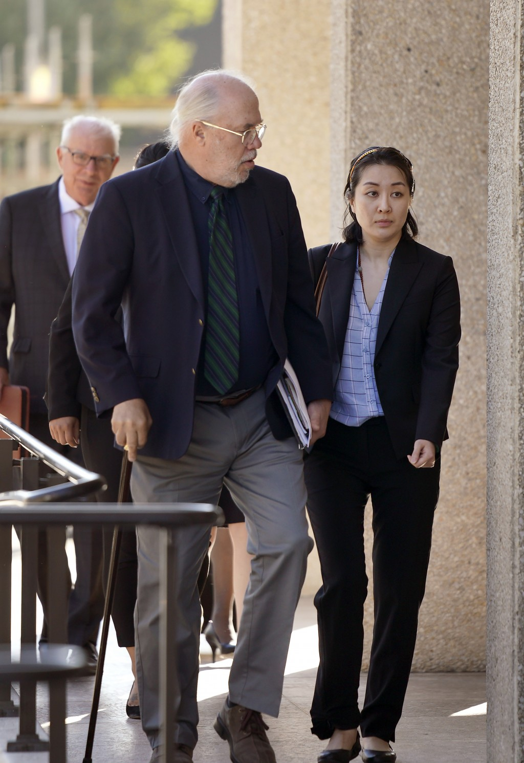 Tiffany Li, right, and her attorney Geoff Carr, left, arrive at the courthouse Thursday, Sept. 12, 2019, in Redwood City, Calif. The trial of Li, a Ch...