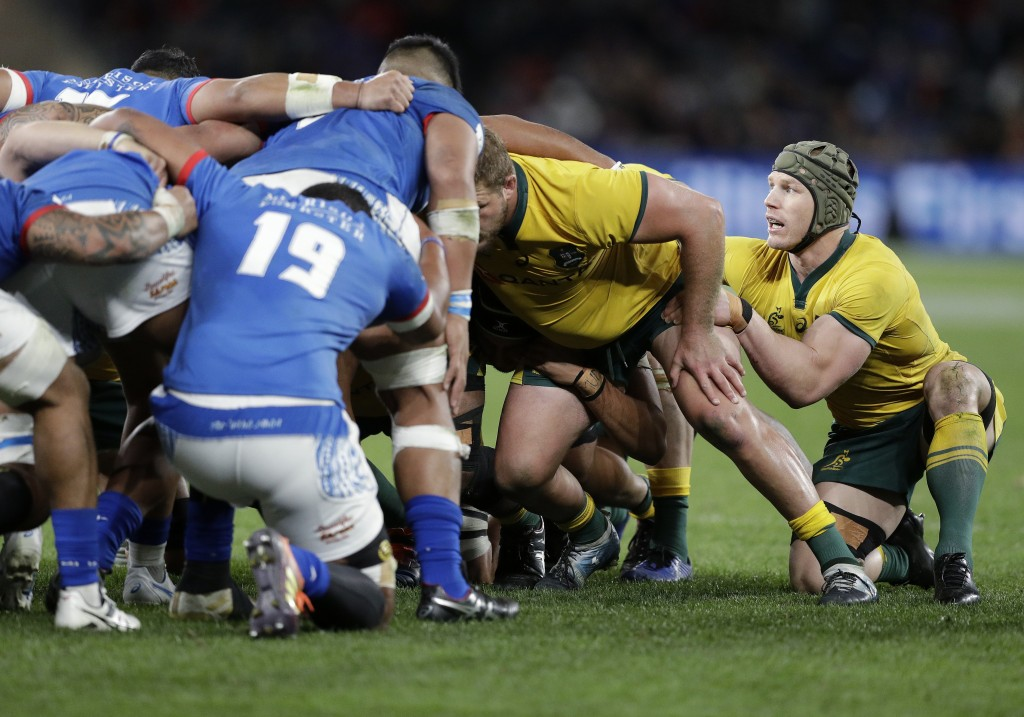 Australia's David Pocock, right, prepares to join a scrum on the flank during their rugby union test match against Samoa in Sydney, Saturday, Sept. 7,...