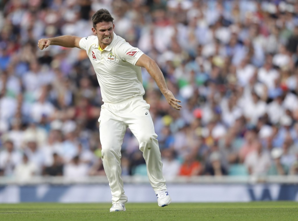 Australia's Mitchell Marsh celebrates taking the wicket of England's Sam Curran during the first day of the fifth Ashes test match between England and...