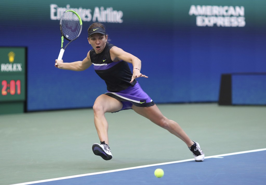 Simona Halep, of Romania, chases down a shot from Taylor Townsend, of the United States, during the second round of the US Open tennis championships T