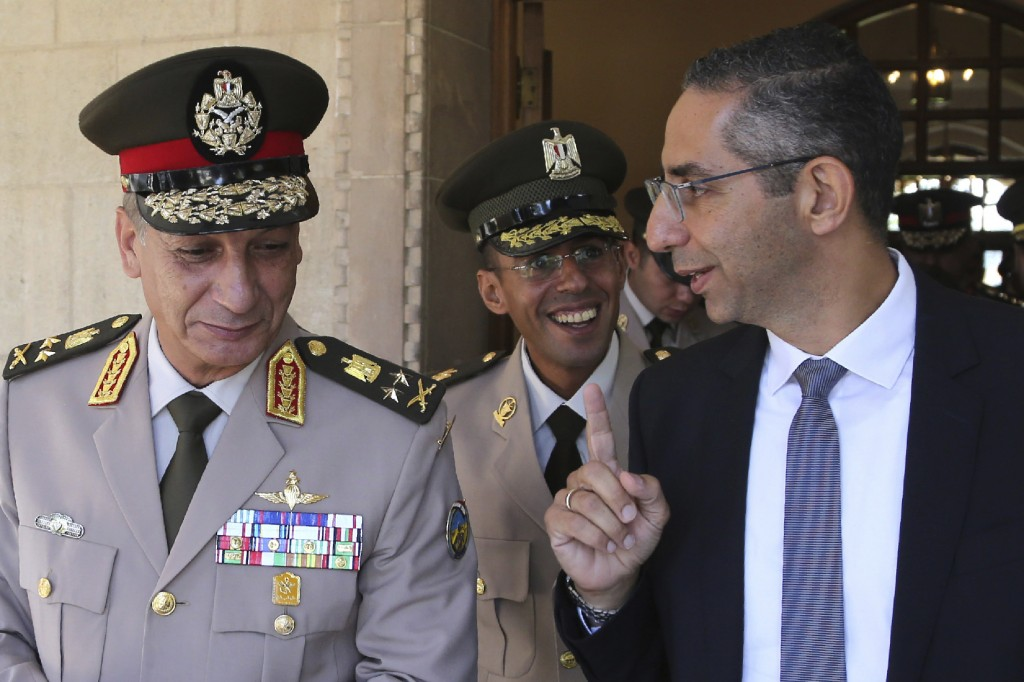 Cyprus' defense minister Savvas Angelides, right, talks with his Egyptian counterpart Lt. Gen. Mohamed Ahmed Zak, left, after a meeting with Cypriot p