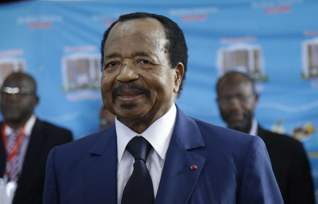 FILE - In this Sunday Oct. 7, 2018 file photo, Cameroon's Incumbent President Paul Biya, of the Cameroon People's Democratic Movement party, wait to c