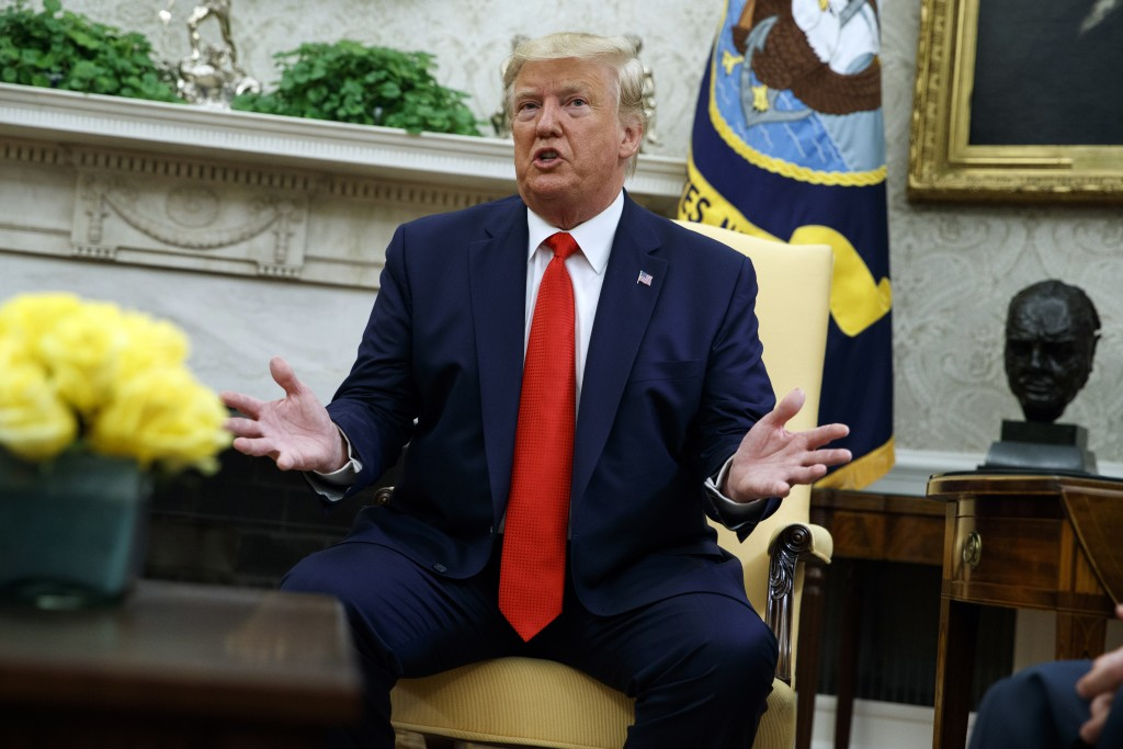 President Donald Trump talks about a plan to ban most flavored e-cigarettes, in the Oval Office of the White House, Wednesday, Sept. 11, 2019, in Wash