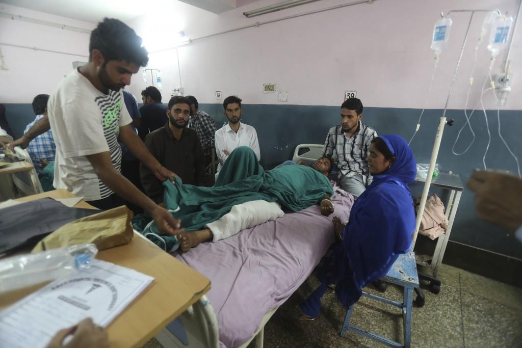 FILE - In this Saturday, Sept. 7, 2019, file photo, injured Kashmiri Mohammad Ashraf Dar lies on a hospital bed in Srinagar, Indian controlled Kashmir