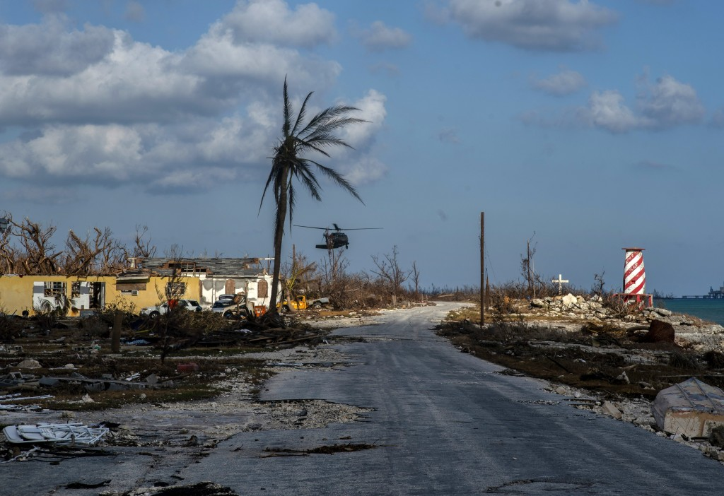 A helicopter flies over the village of High Rock after delivering emergency supplies in the aftermath of Hurricane Dorian In High Rock, Grand Bahama, ...