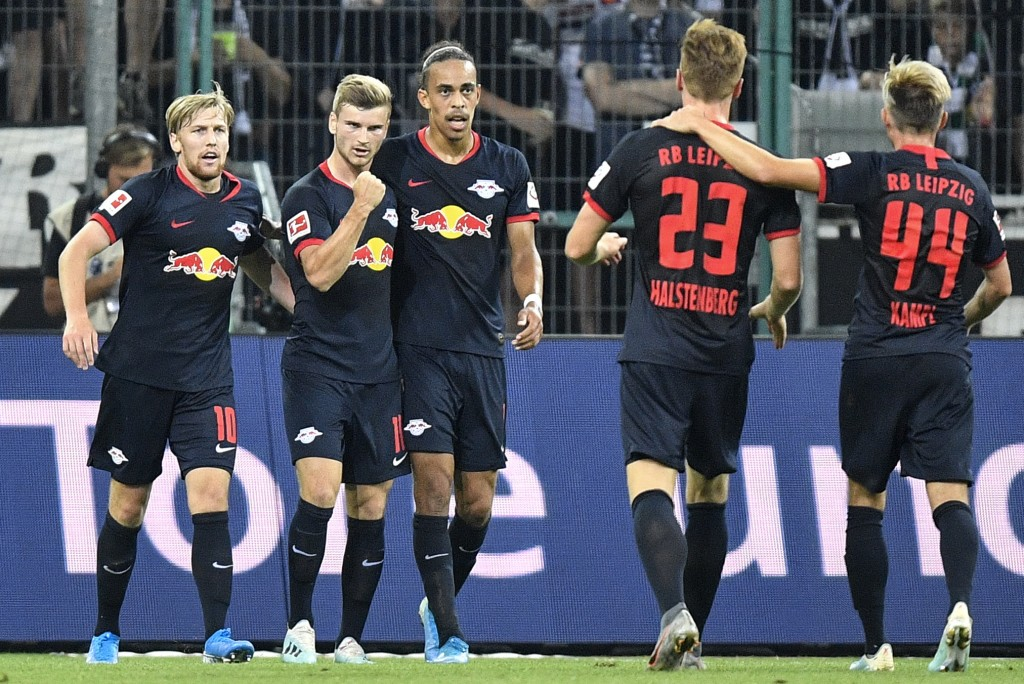 Leipzig's Timo Werner, 2nd from left, celebrates with his team after he scored the opening goal during the German Bundesliga soccer match between Boru...