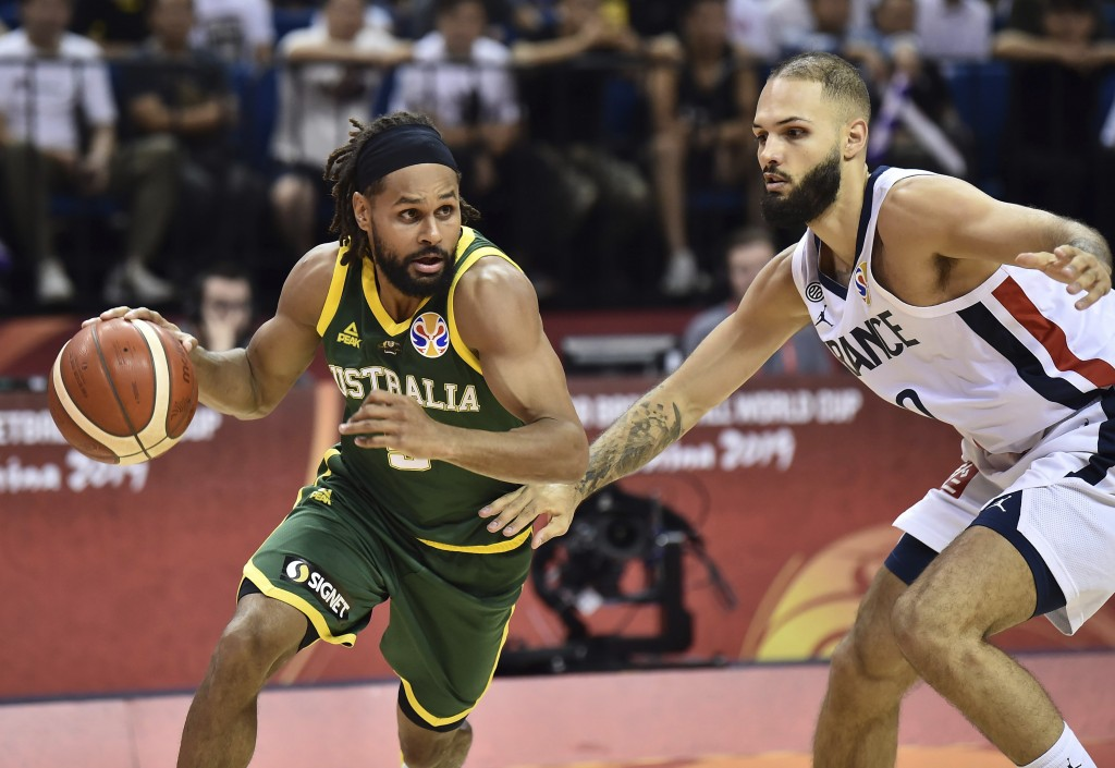 Patty Mills of Australia drives against Evan Fournier of France during their second round basketball game in the FIBA Basketball World Cup in Nanjing