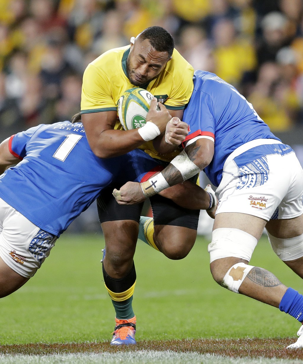 Australia's Sekope Kepu, center, is sandwiched by Samoa's Jordan Lay, left, and Afa Amosa during their rugby union test match in Sydney, Saturday, Sep