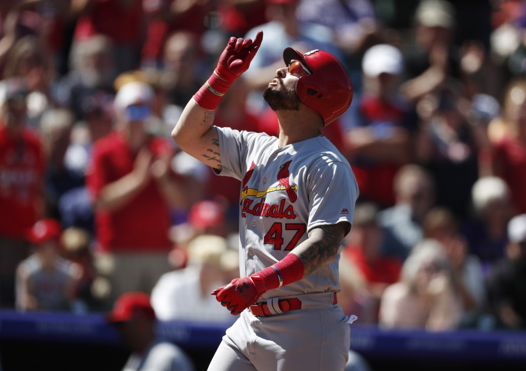 St. Louis Cardinals' Rangel Ravelo gestures as he crosses home plate after hitting a solo home run off Colorado Rockies starting pitcher Tim Melville