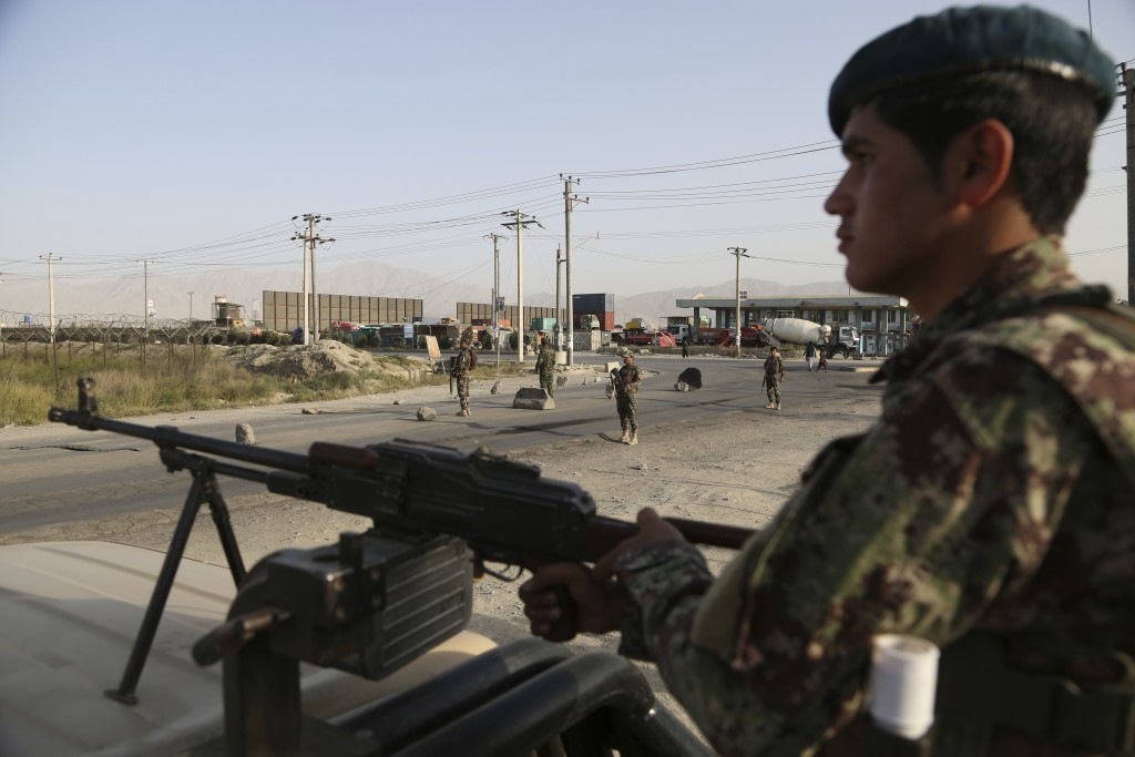 In this Tuesday, Sept. 10, 2019, photo, Afghan National Army soldiers stand guard at a checkpoint in Kabul, Afghanistan. President Donald Trump says U...