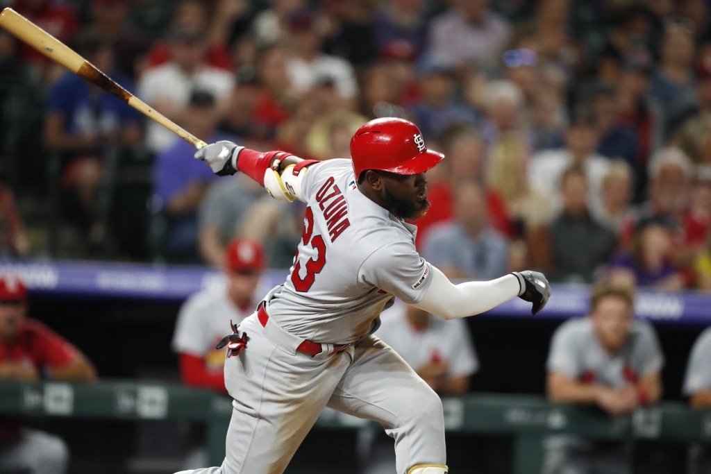 St. Louis Cardinals' Marcell Ozuna strikes out against Colorado Rockies relief pitcher Jairo Diaz to end the top of the eighth inning of a baseball ga