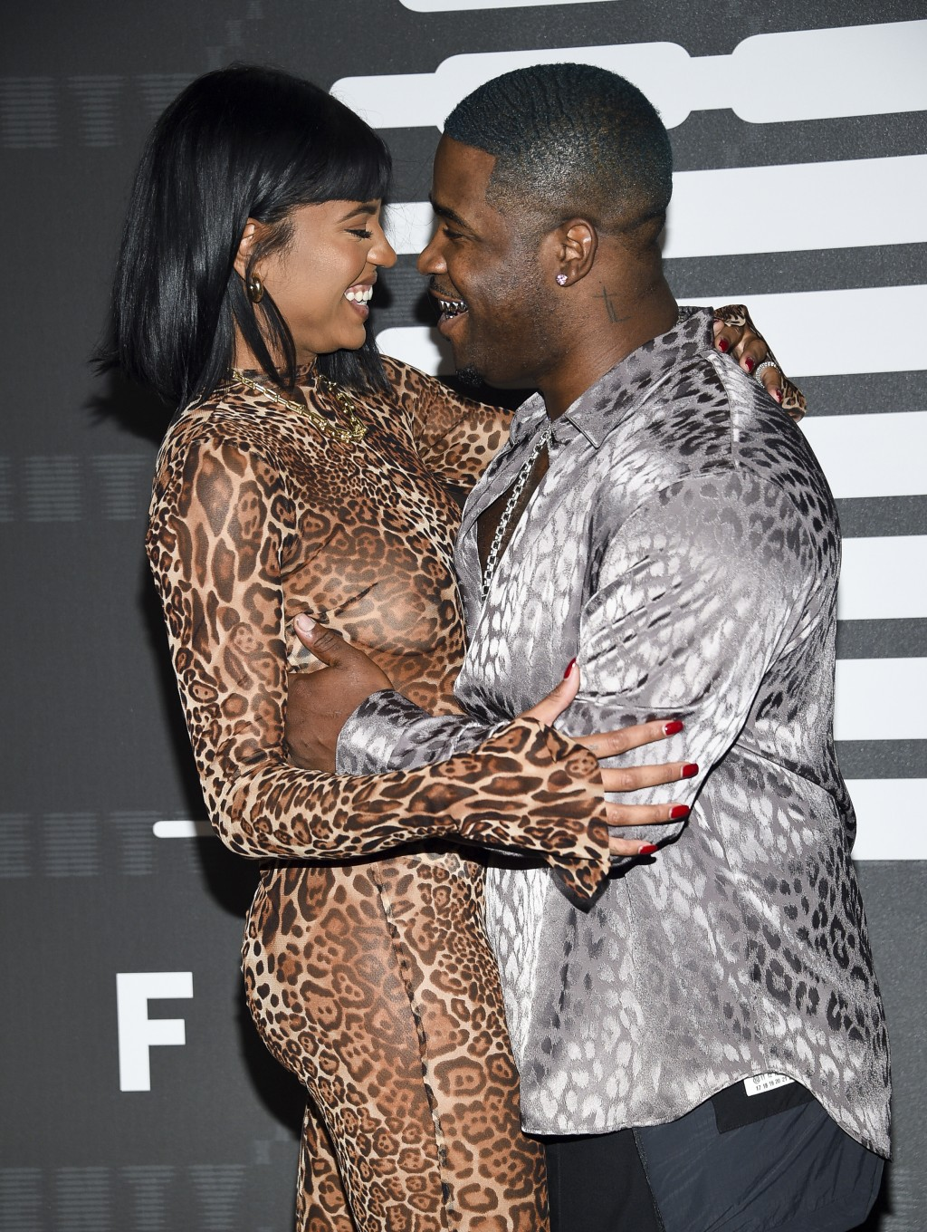 Rapper A$AP Ferg, right, and girlfriend Renell Medrano attend the Spring/Summer 2020 Savage X Fenty show, presented by Amazon Prime, at the Barclays C...