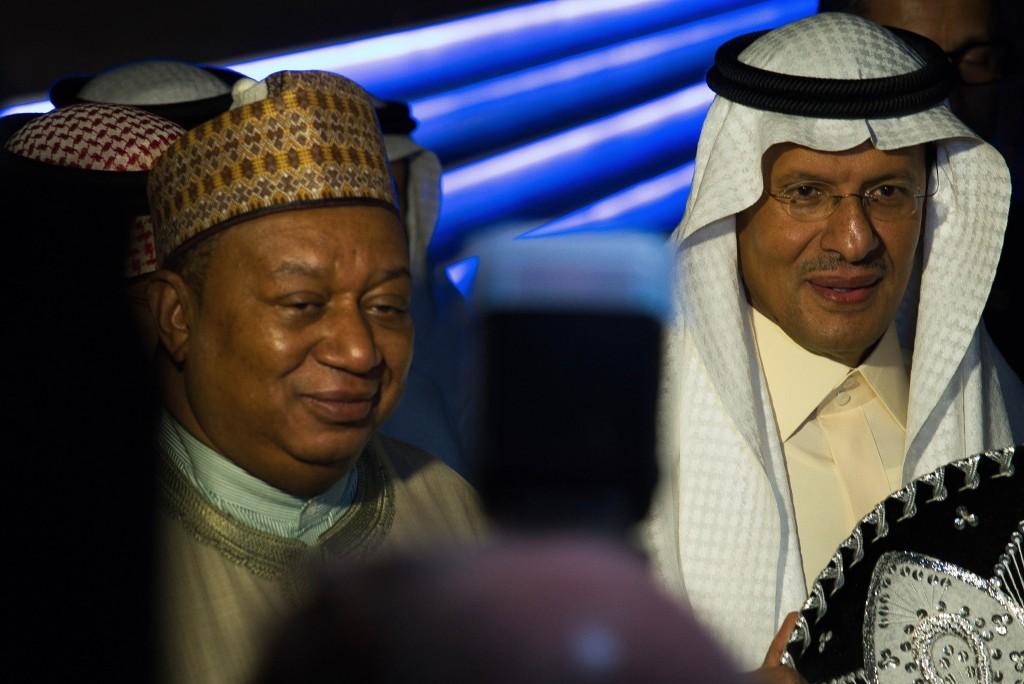 Saudi Arabia's new Energy Minister Prince Abdulaziz bin Salman, right, and OPEC Secretary-General Mohammed Barkindo speak to journalists at the World
