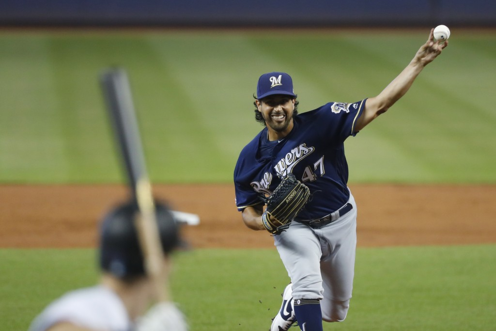 Milwaukee Brewers' Gio Gonzalez pitches to Miami Marlins' Jon Berti during the first inning of a baseball game, Thursday, Sept. 12, 2019, in Miami. (A