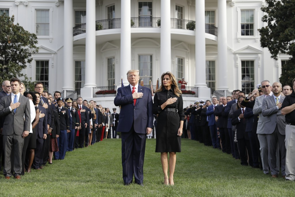 President Donald Trump and first lady Melania Trump participate in a moment of silence honoring the victims of the Sept. 11 terrorist attacks, on the ...