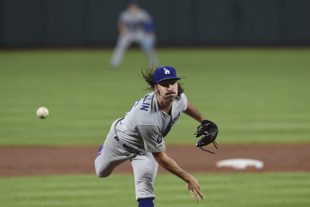 Los Angeles Dodgers pitcher Tony Gonsolin throws against the Baltimore Orioles in the sixth inning of a baseball game, Thursday, Sept. 12, 2019, in Ba...