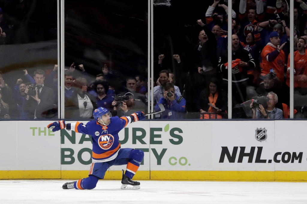 FILE - In this April 10, 2019, file photo, New York Islanders right wing Jordan Eberle reacts after scoring a goal on the Pittsburgh Penguins during t...