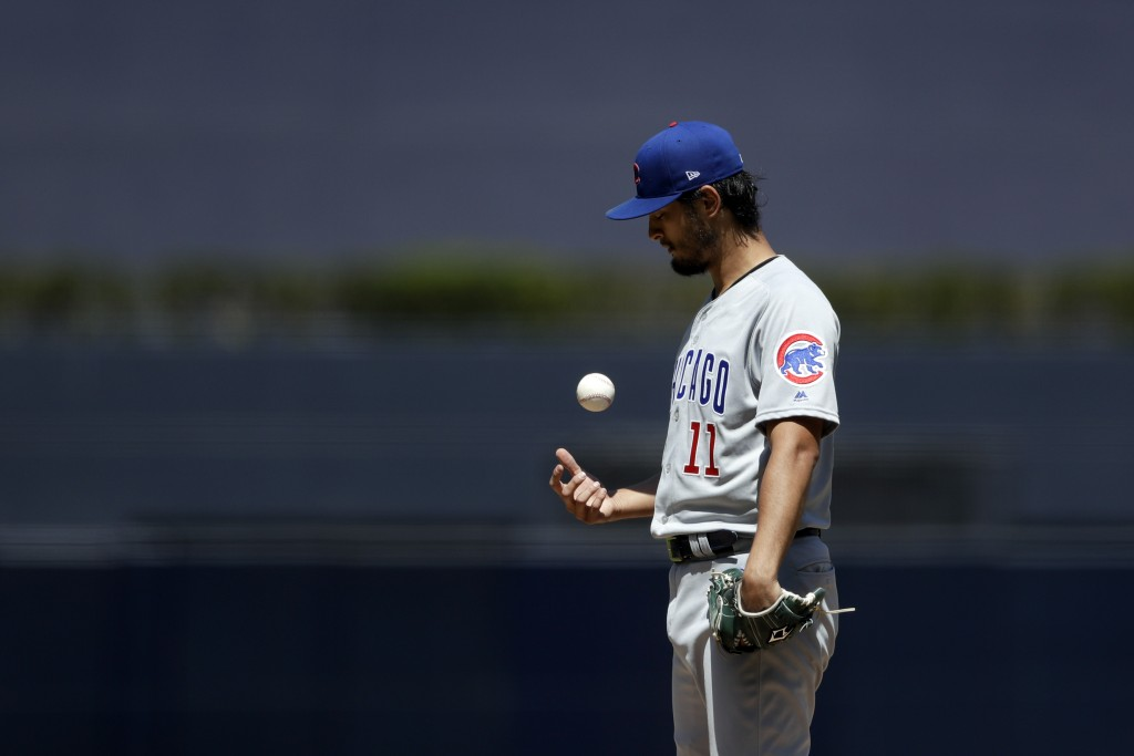 Chicago Cubs starting pitcher Yu Darvish tosses the ball as he works against a San Diego Padres batter during the first inning of a baseball game Thur...