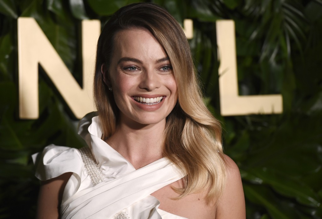 Actress Margot Robbie poses for photographers at the launch of the Gabrielle Chanel Essence fragrance at the Chateau Marmont, Thursday, Sept. 12, 2019