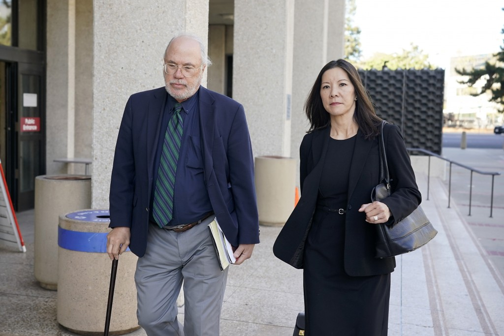 Geoffrey Carr, left, and May Mar, attorney's for Tiffany Li, walk out of the courthouse after opening statements were delayed in Li's trial, Thursday,
