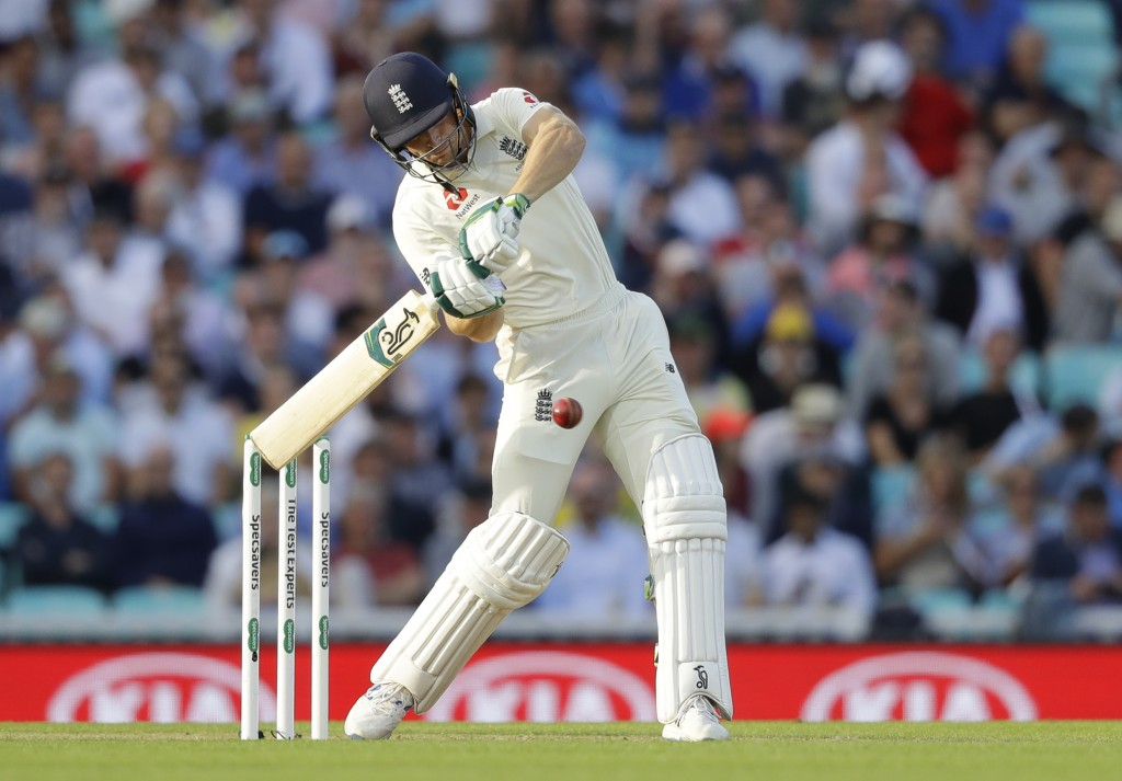 England's Jos Buttler plays a shot for six off the bowling of Australia's Josh Hazlewood during the first day of the fifth Ashes test match between En